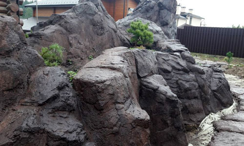 Частичная покраска декоративной скалы